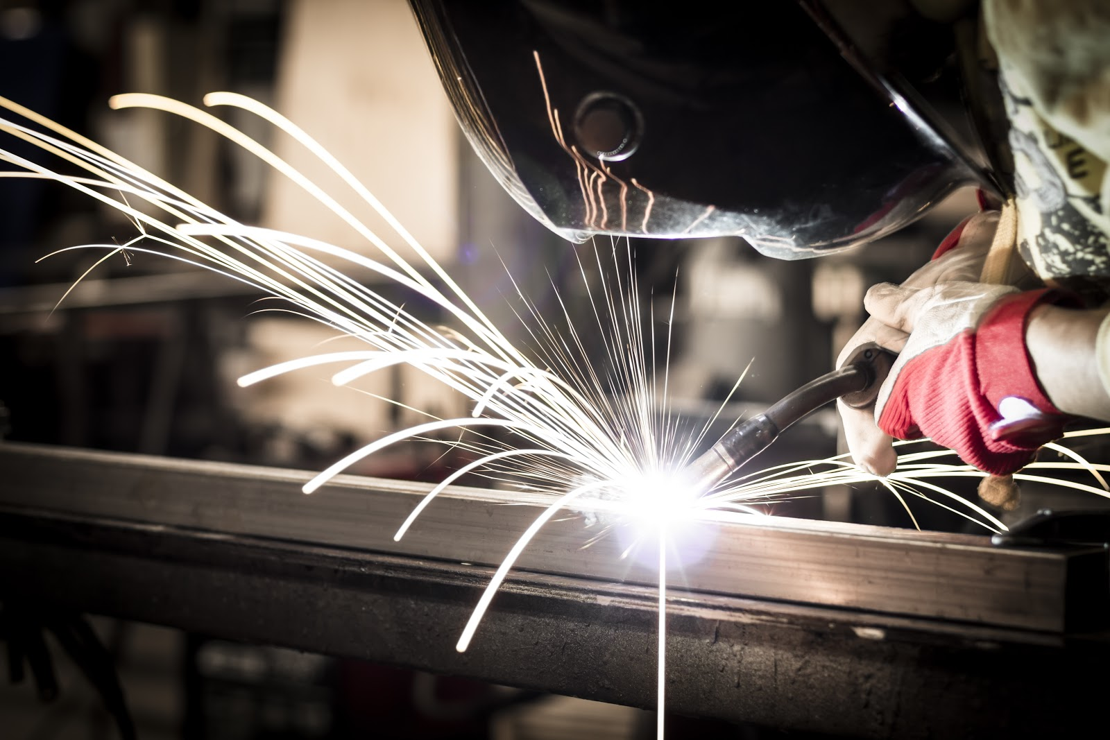 Welder gently works on steel material for precise and accurate cuts at the Kalisch Welding Shop